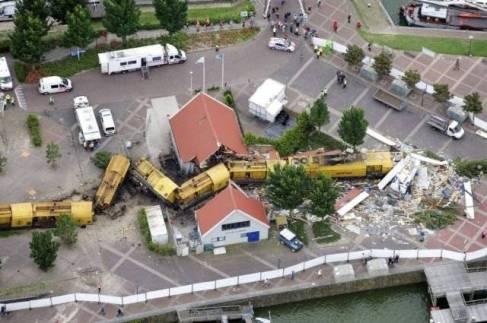 derailed train through house