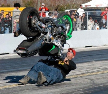 bike flips over during a stunt show