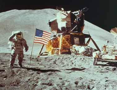 neil armstrong salutes with american flag and spaceshift behind