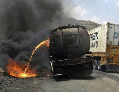 petrol on fire from fuel truck