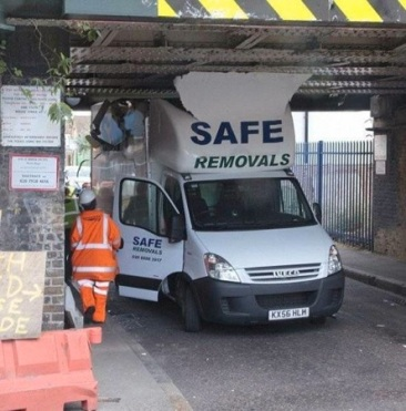 van drives into garage with too high a roof